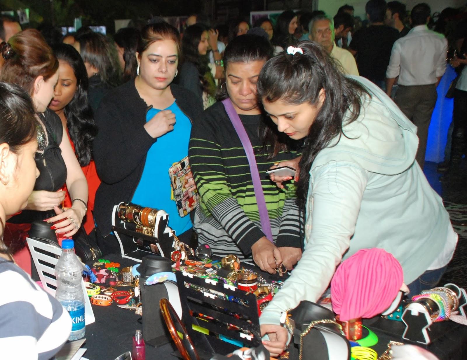 Guests shopping at Cupid's Flea Market at Villa 69