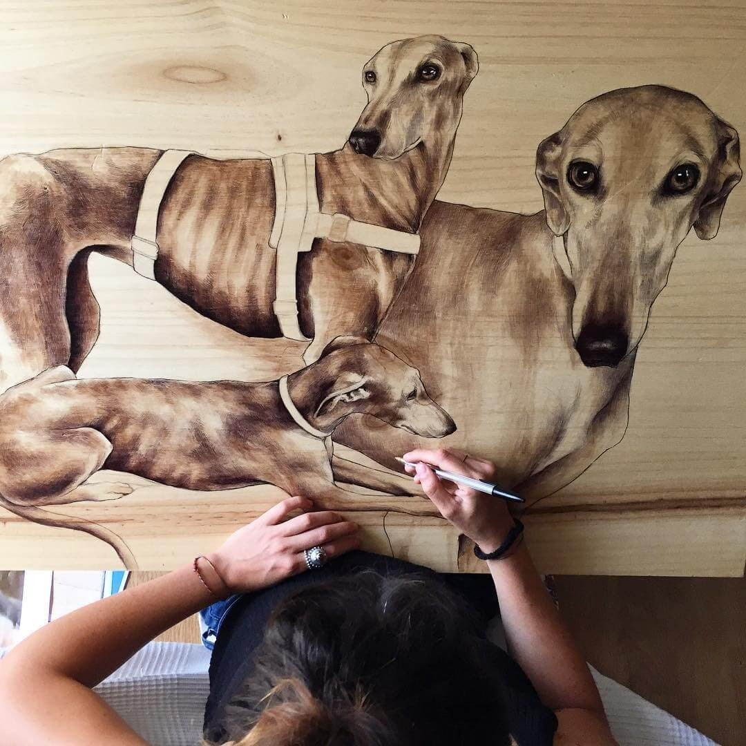 10-The-Greyhound-Martina-Billi-Animal-Drawings-on-Recycled-Wooden-Planks-www-designstack-co