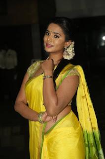 Actress Manasa Stills in Yellow Saree at Savitri Audio Launch  0008