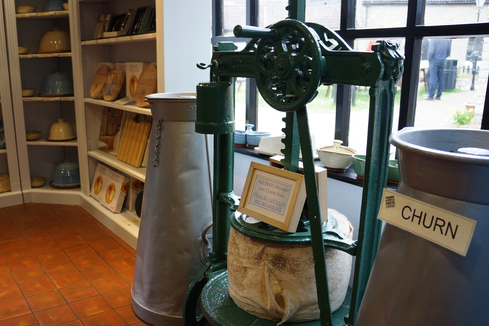 an antique cheese press