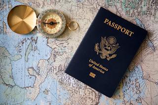 Passport and compass against a map background, Cedar Park, Texas, USA