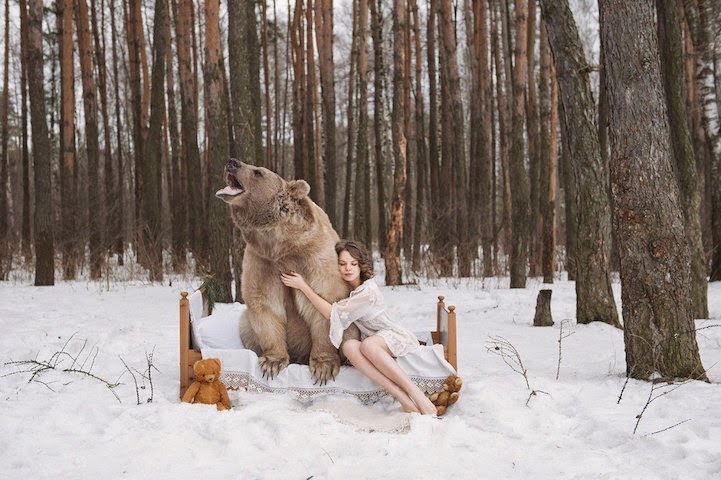 Russian model posing with real bear