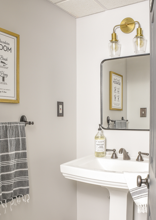 Vintage modern bathroom with black metal frame