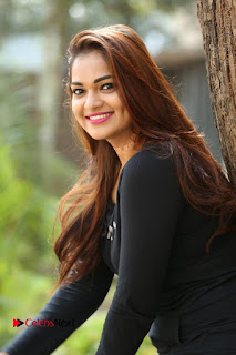 Actress Aswini Latest Stills in Black Denim Jeans  0035.JPG