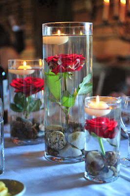 diyas on red rose in glass