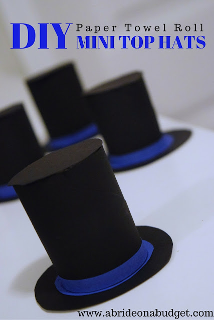 How SUPER CUTE are these DIY mini top hats from www.abrideonabudget.com? They're made from an empty paper towel roll too! Check out the link to find out how to make your own cardboard top hats!