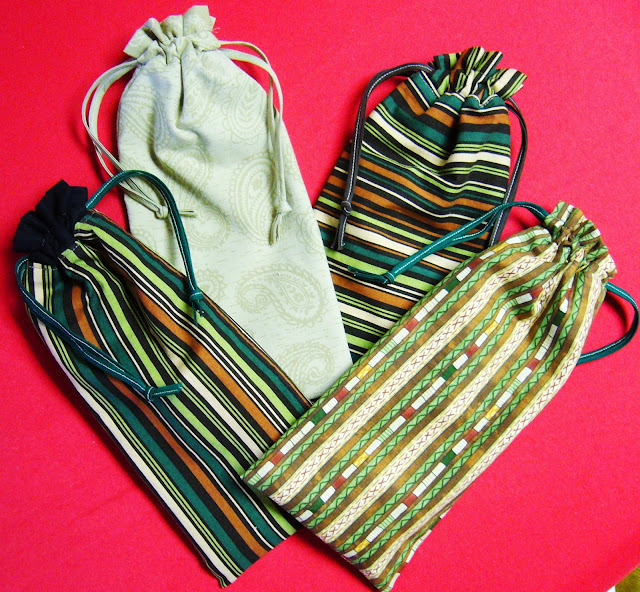 Reversible drawstring pencil pouches.