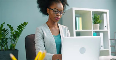 Black business woman at computer