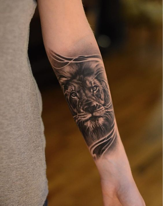 Stunning lion tattoo designs for girl on forearm