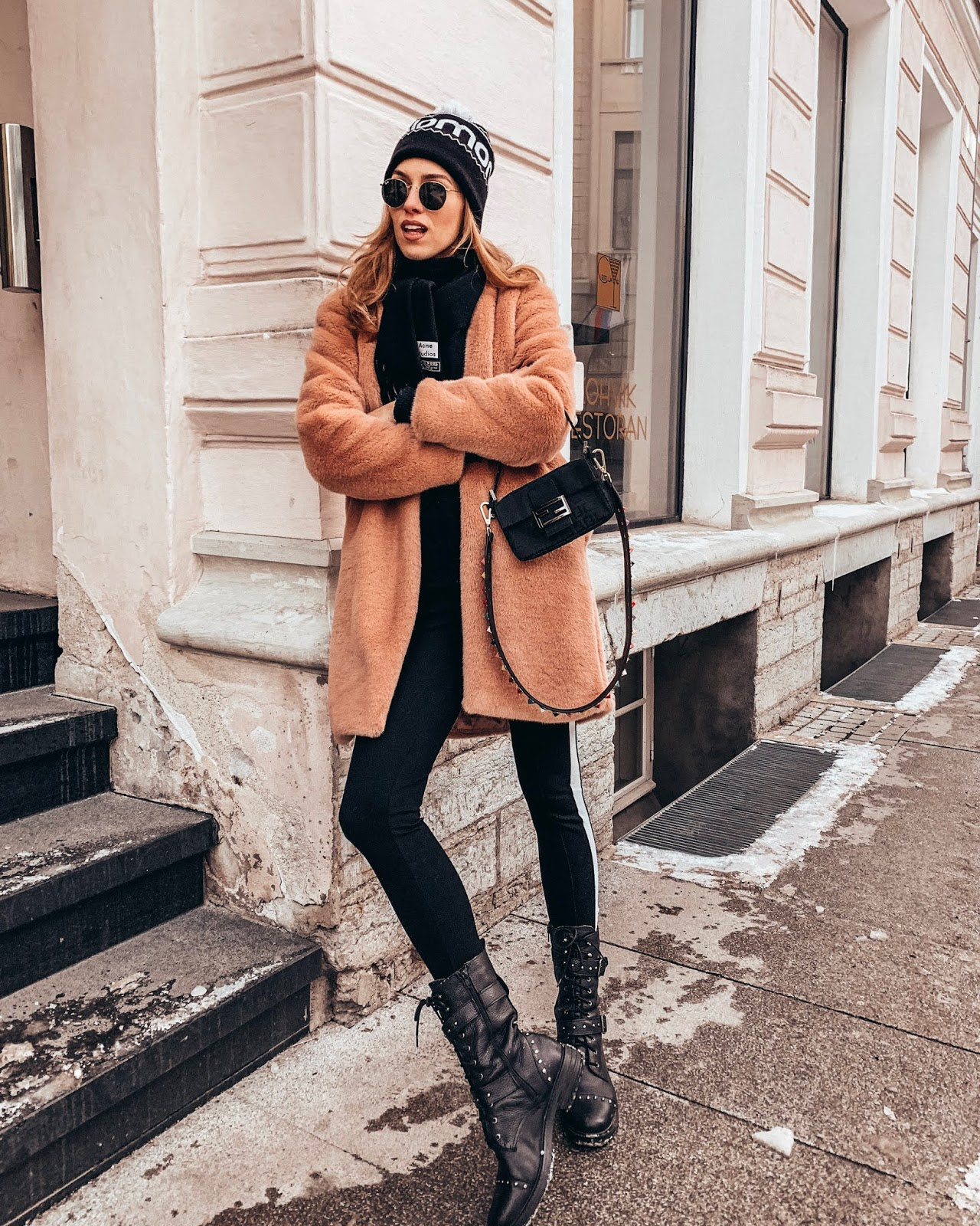 pink faux fur coat acne scarf fendi baguette bag ray ban round sunglasses beanie winter outfit