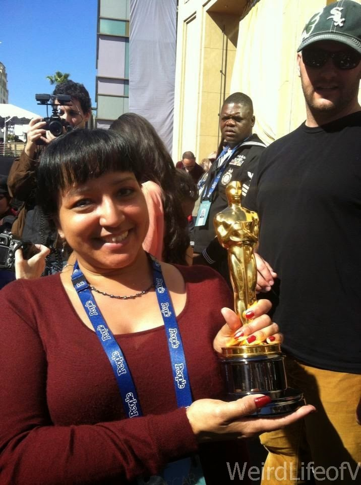 I got to hold a real Oscar statuette while in the bleachers for the 2013 Oscars.