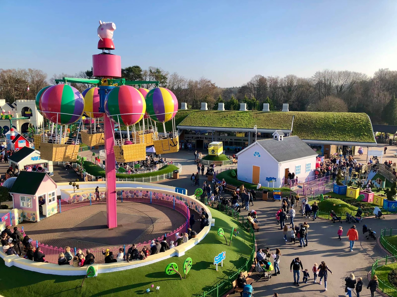 high up view of peppa pig world paultons park on a sunny day with blue sky
