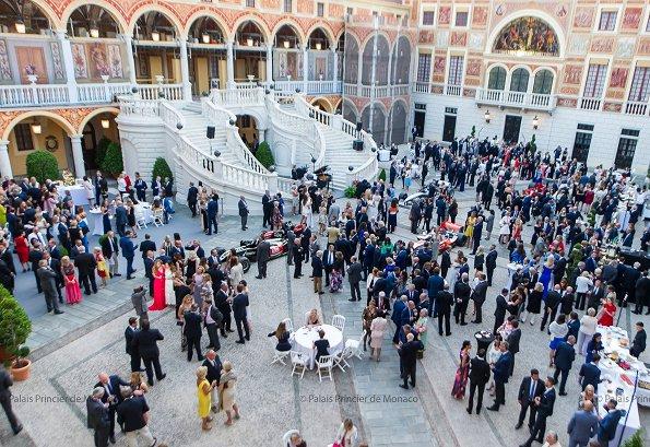 Prince Albert and Princess Charlene held a reception for 75th Monaco Grand Prix Formula 1 at Principality Palace. Princess wore Akris Pantsuit