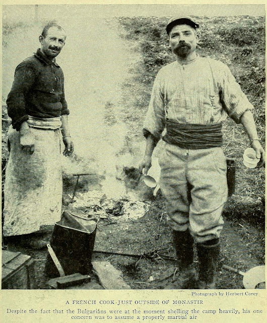 Photograph by Herbert Corey A FRENCH COOK JUST OUTSIDE OF MONASTIR Despite the fact that the Bulgarians were at the moment shelling the camp heavily, his one concern was to assume a properly martial air