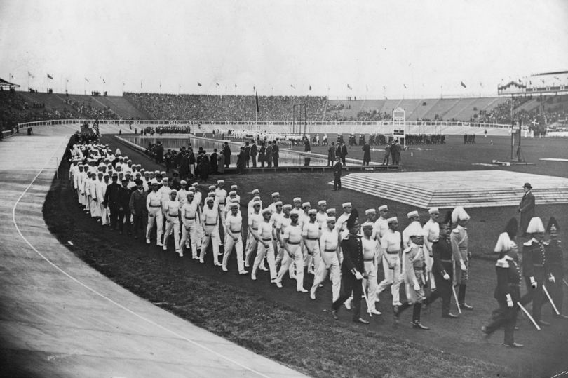 Diving in the middle of the field. Swedish athletes in a march-past during the 1908 Summer Olympics in London, White City Stadium. Your Russians are missing and other stories about past Olympics. marchmatron.com