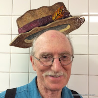 rider wears hat at 23rd Street subway station in NYC