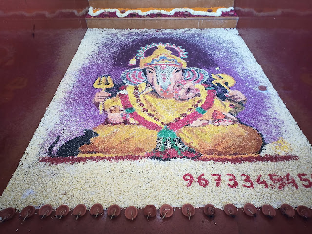 Ganesh made from coloured powder at Shreemant Dagdusheth Halwai Ganpati Mandir