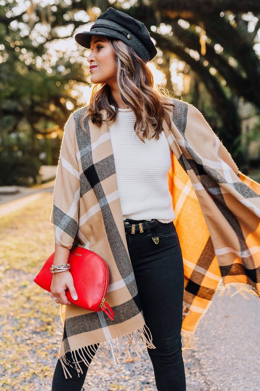 trendy outfit idea with a hat : white sweater + clutch + plaid poncho + skinnies
