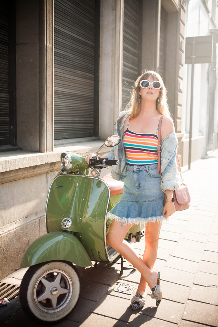 Outfit: scooter, rainbow stripes and mules