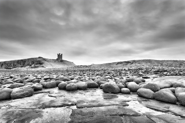 Dunstanburgh Castle from the Northumberland shore by Martyn Ferry Photography