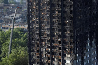 UK to hold inquiry into London tower block fire as death toll rises to 17