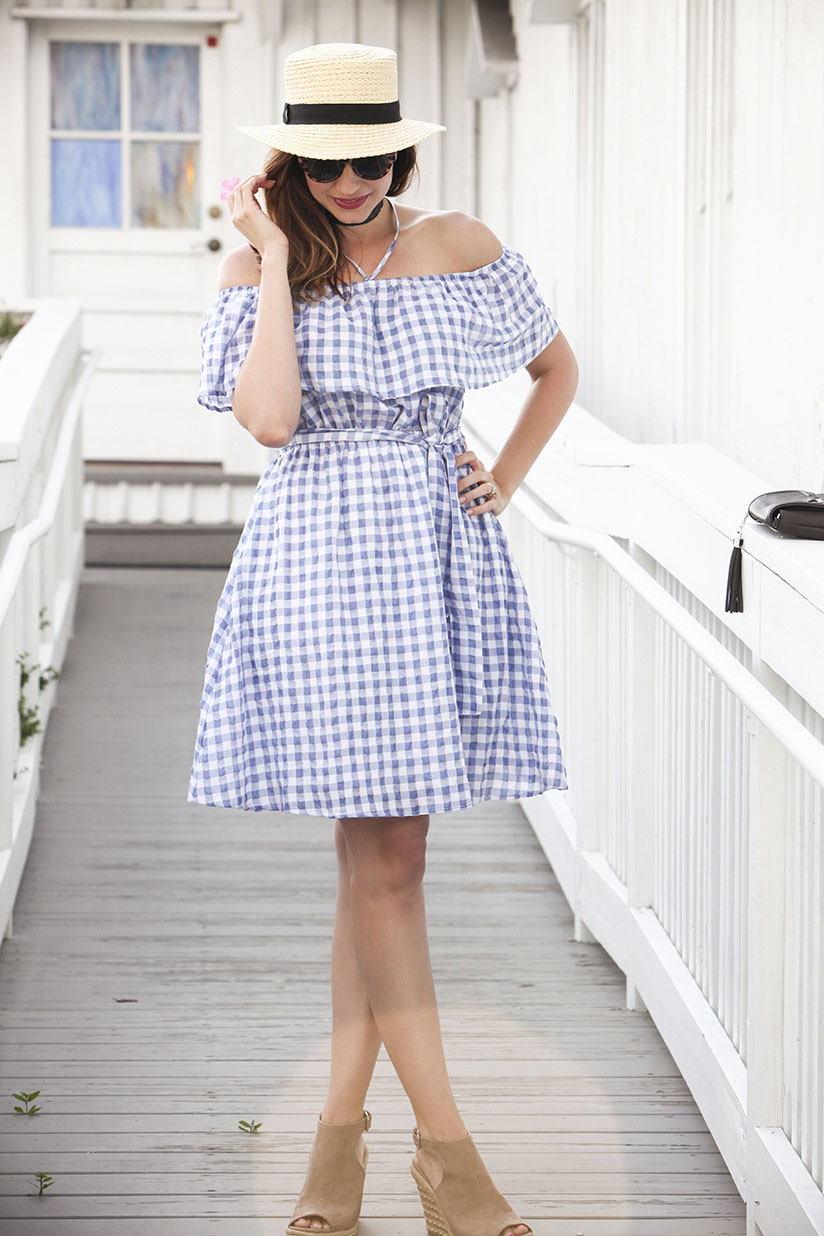 Amy West in a gingham spring dress