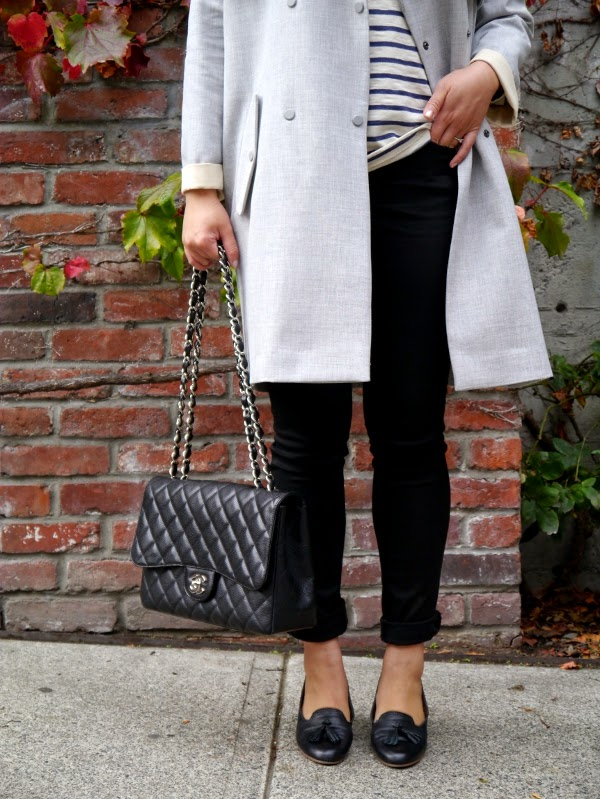 Oversize grey trench, Breton striped top, black skinny jeans, black Chanel 2.55, black tassel slippers