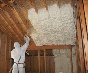 contractor insulating with spray foam