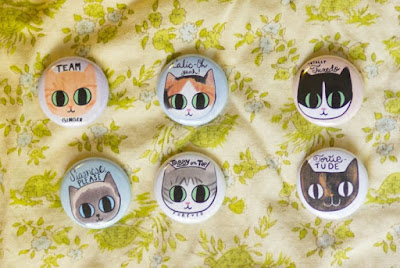 Cat Party magnet collection: six circular magnets, each with a different cat face.