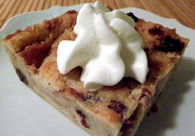 Square of Bread Pudding topped with Whipped Cream