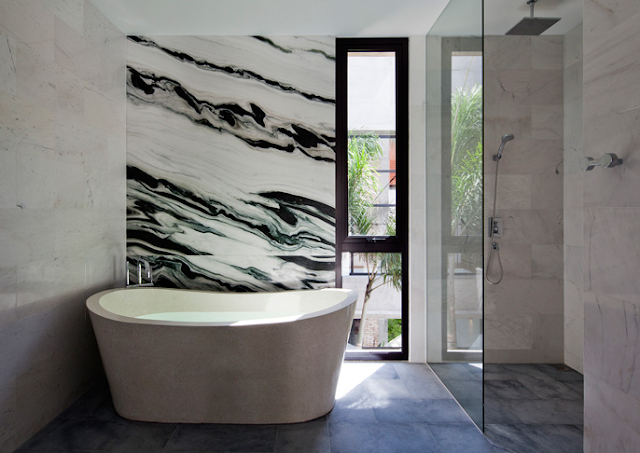 Marble surfaces throughout the bathroom
