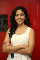 Actress Ritu Varma Stills in White Floral Short Dress at Kesava Movie Success Meet .COM 0067.JPG