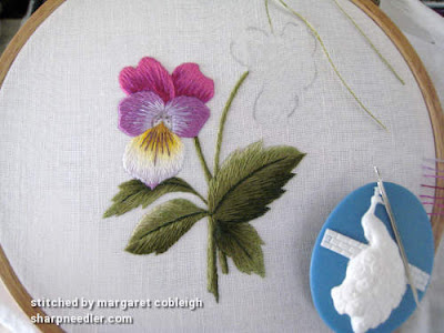 In progress photos of needlepainted pansy/viola. Stems, leaves, and most of main flower completed