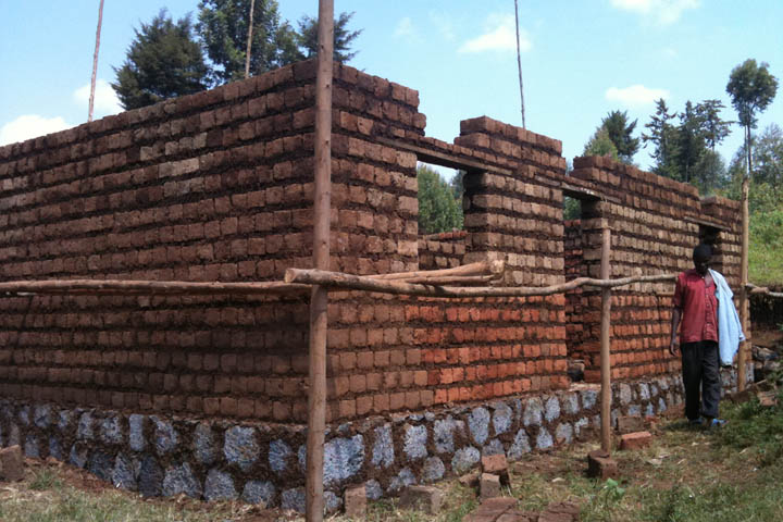 The Picture To Right Is Of A Building Under Construction In Rwanda Note Surface Foundation Rough Hewn Stone Or Rock
