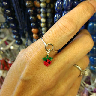 Click here to see a cute handmade sterling silver ring with beaded charm.