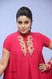 Actress Poorna Latest Stills in Red Dress at Rakshasi First Look Launch  0181.JPG