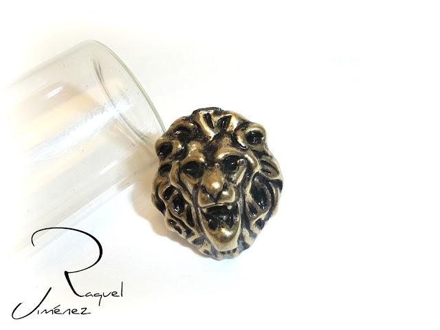 anillo cabeza de leon