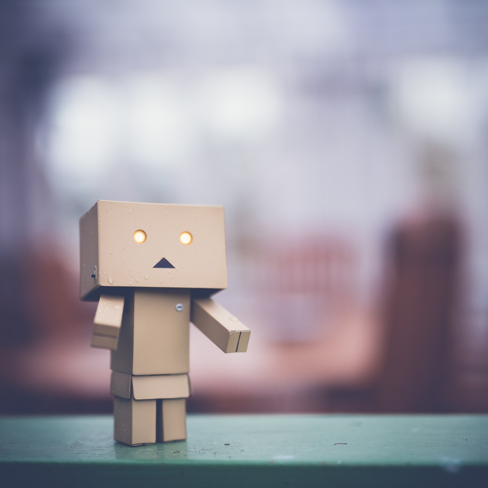 negative thinking - cardboard robot with a grumpy face