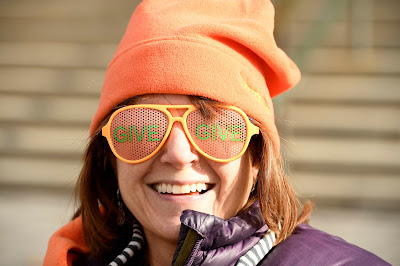 Angela Bevacqua, Senior Communications Specialist, wears give glasses and an orange hat to celebrate Colorado Gives Day 2016