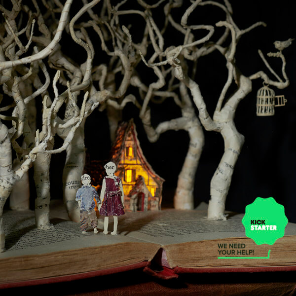 altered book art scene with trees, tiny house and boy and girl made of book page paper