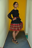 Aditi Myakal in Spicy Red Short Skirt and Transparent Black Top at at Big FM For Promotion of Movie Ami Tumi 073.JPG