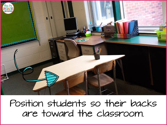 Position students so they are facing away from the rest of the classroom.