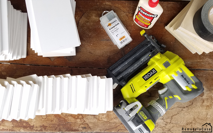 the materials: shiplap, Ryobi brad nailer, wood glue