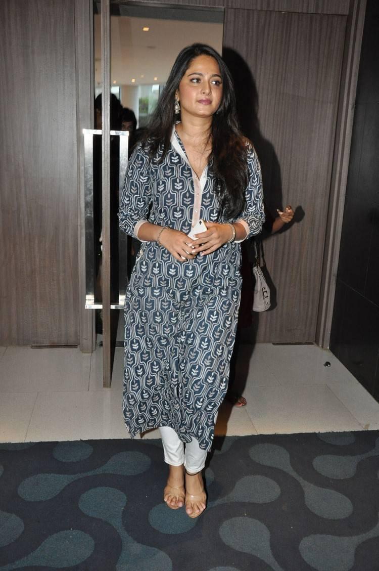 Anushka Stills In Blue Dress at Movie Promotion