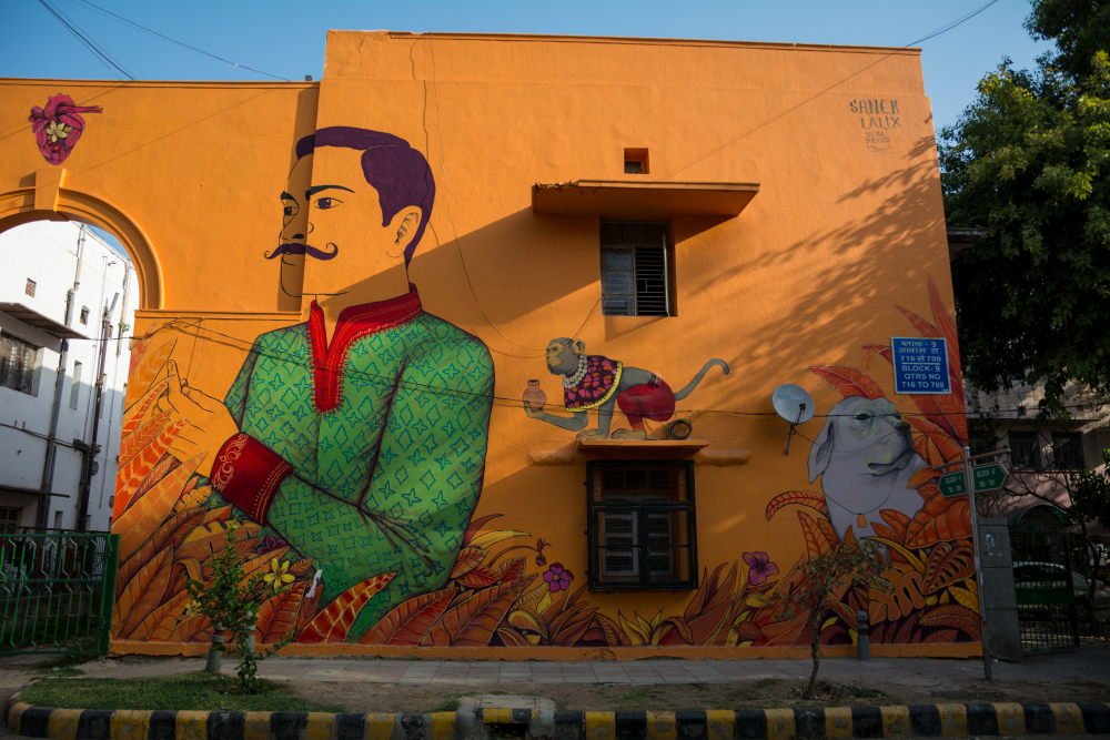 here are all the 52 pop murals at lodhi art district in delhion the sides, a man and a woman represent the order and balance in the universe, their clothes and adornments identify mexican and