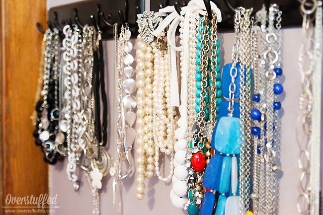 Coat hooks are excellent for storing your necklaces on. It is a stylish way to organize and find your jewelry. #overstuffedlife