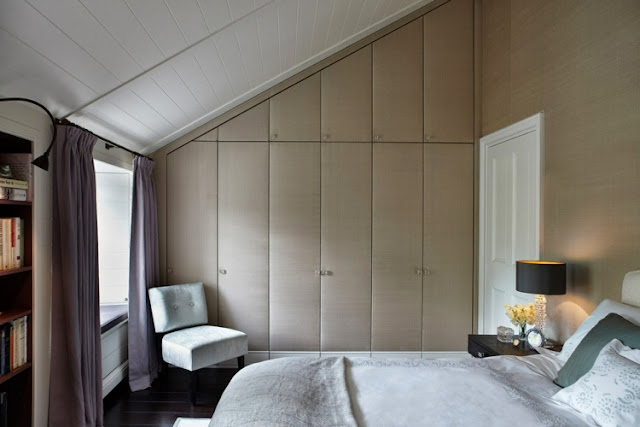 Custom cabinet under roof with light beige in the bedroom