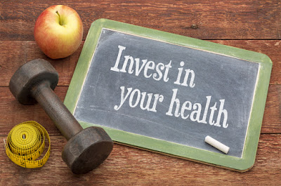 "A chalkboard message that reads, ""Invest in your health."""