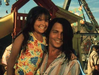 Johnny Depp as Raphael in The Brave, with his daughter, living the shantytown, Directed By Johnny Depp