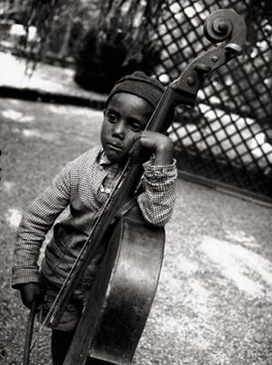 http://kvetchlandia.tumblr.com/post/157267117363/eva-besny%C3%B6-roma-boy-with-cello-hungary
